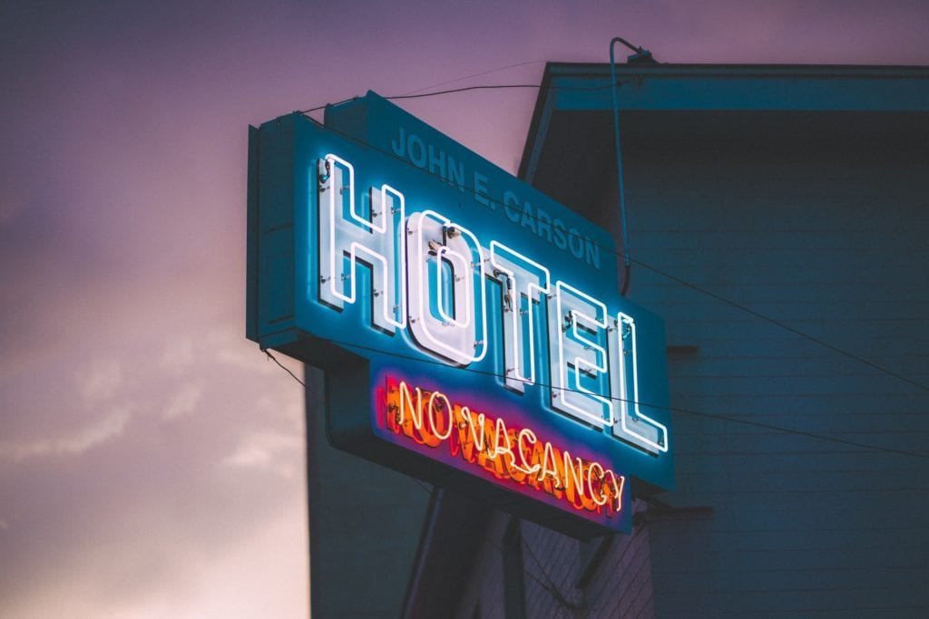 Neon hotel sign for probiotic eco cleaning products blog
